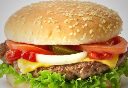 Cheeseburger with lettuce, tomato, onion, pickles ketchup, sesame seed bun